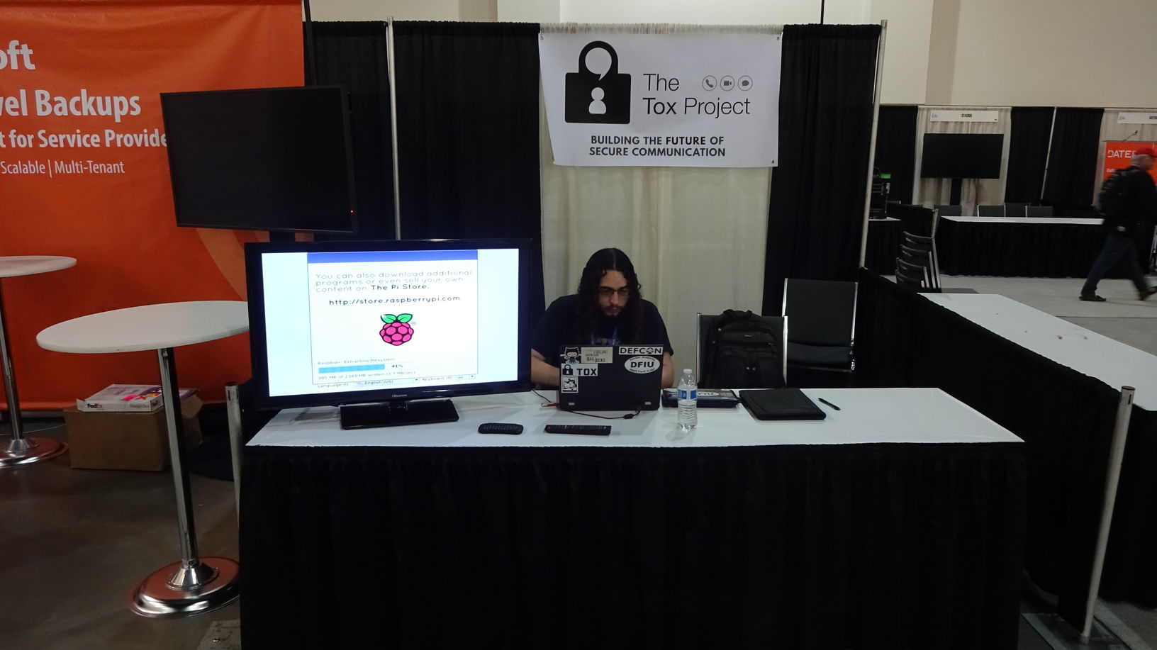 Setting up the booth before the expo floor opens to the conference-goers