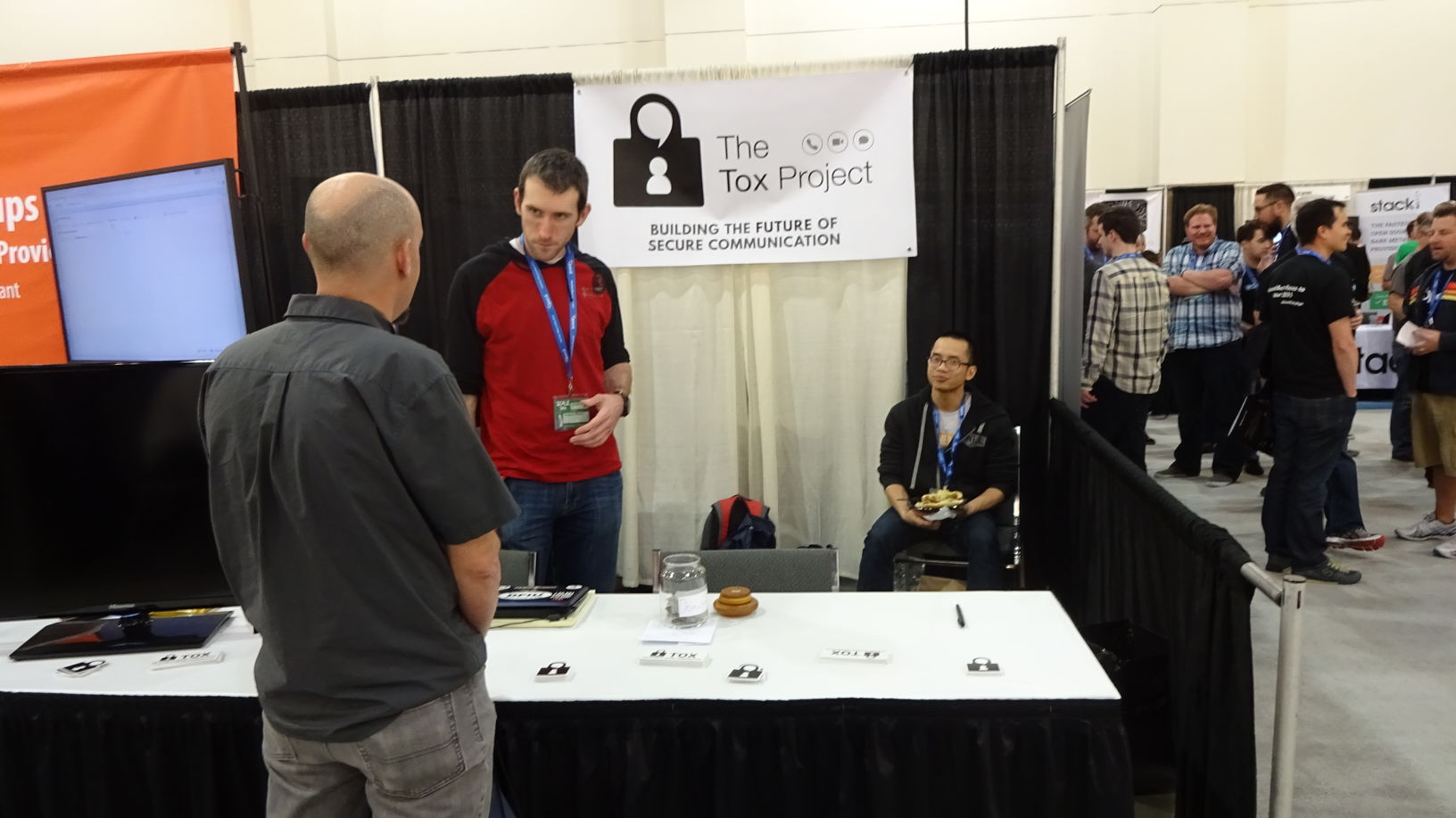 Greg Mullen (left) and Chuong Vu (right) explaining Tox to an expo attendee