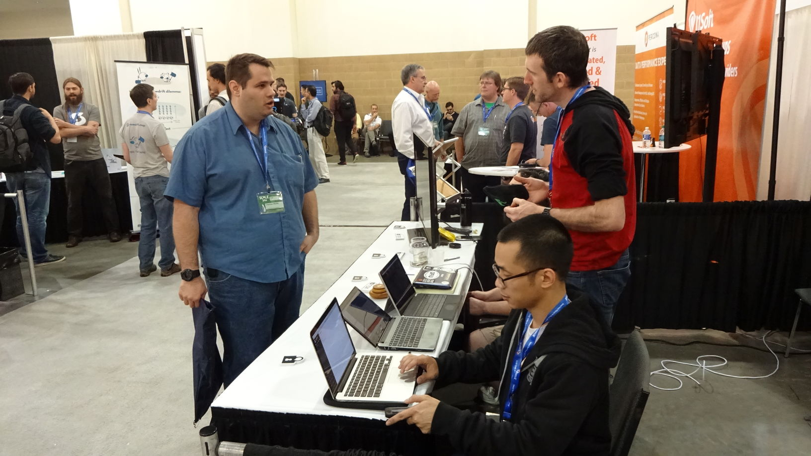 Chuong Vu (near) and Greg Mullen (far) explaining Tox to an expo attendee